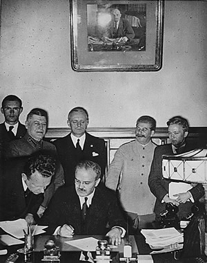 August 23, 1939.  Vyacheslav Molotov, the Chairman of the Council of People's Commissars of the Soviet Union, signing the Nazi-Soviet Pact.